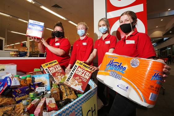 Coles Leopold staff with donations.